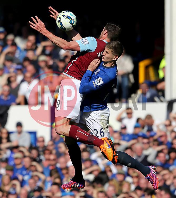 Everton's John Stones challenges Burnley's Sam Vokes  - Photo mandatory by-line: Matt McNulty/JMP - Mobile: 07966 386802 - 18/04/2015 - SPORT - Football - Liverpool - Goodison Park - Everton v Burnley - Barclays Premier League