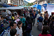 BU00017-00...BHUTAN - Locals, many in traditional dress visiting the festival market during the Thimphu Drubchen (festival).