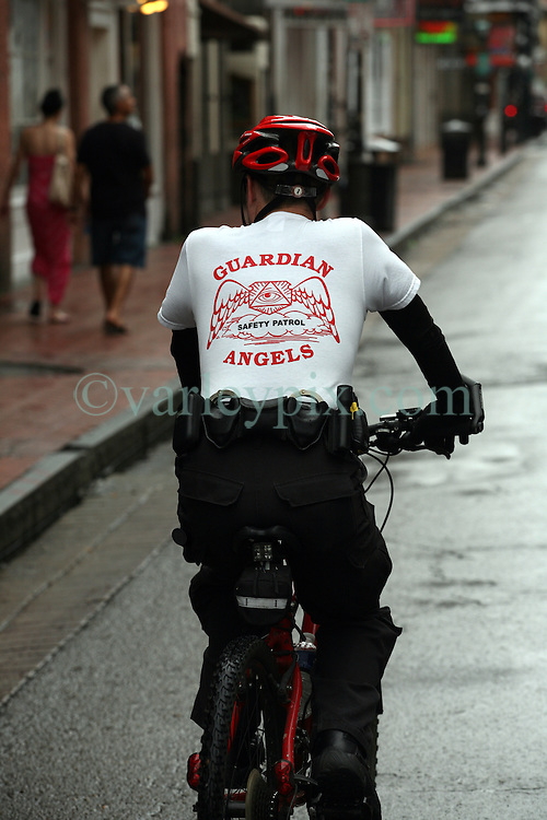 28 August 2012. New Orleans, Louisiana,  USA. <br /> A member of the Guardian Angels patrols an almost deserted Bourbon Street in the French Quarter. The 7th year anniversary of Hurricane Katrina is tomorrow and with a storm lurking in the Gulf many have evacuated as an uneasy calm settles over New Orleans.<br /> Photo; Charlie Varley