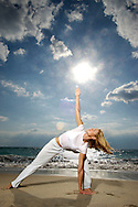 Yoga at sunrise on beach