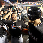 NEW YORK, NEW YORK - July 05: Martin Prado #14 of the Miami Marlins congratulates Giancarlo Stanton #27 of the Miami Marlins as he returns to the dugout after hitting a three run homer in the eighth inning during the Miami Marlins Vs New York Mets regular season MLB game at Citi Field on July 05, 2016 in New York City. (Photo by Tim Clayton/Corbis via Getty Images)
