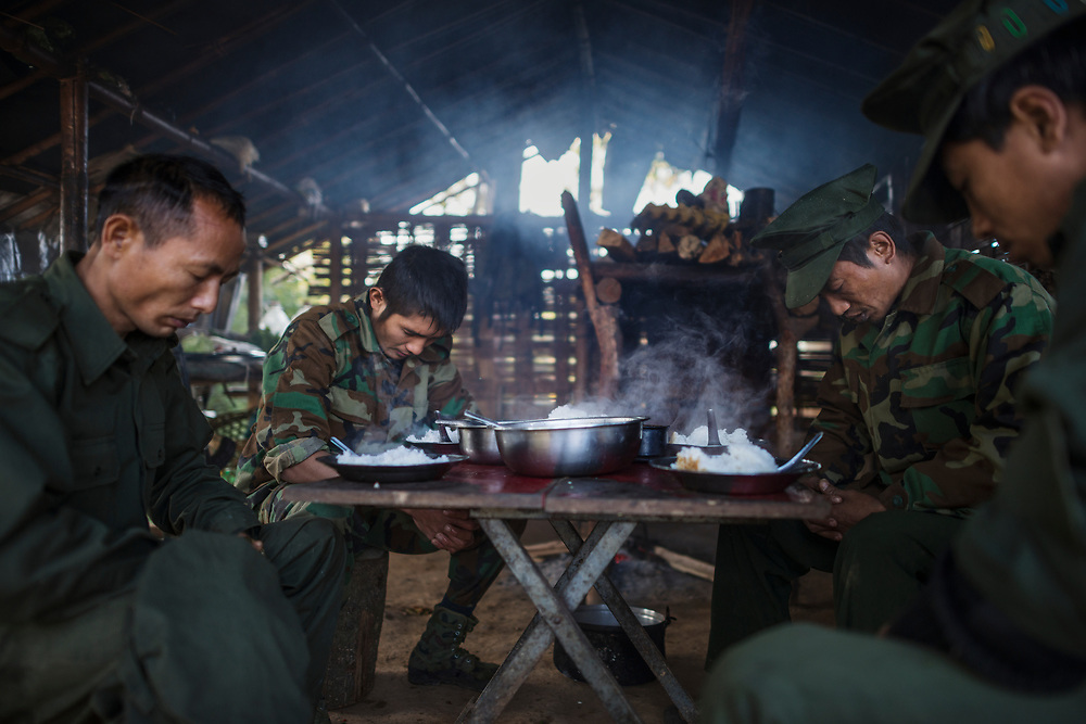 KIA Mobile Brigade, Myanmar 20180124 <br /> Byuwa Yaw Han, Aung Lun, Naw San and Aung Lat, of the Kachin Independence Army, saying grace before breakfast at a frontline outpost just 1 km from the Burma Armys nearest outpost.<br /> Photo: Vilhelm Stokstad / Kontinent