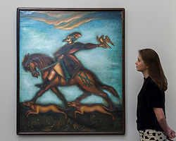 "© Licensed to London News Pictures. 25/11/2016. London, UK. A staff member views ""The Hunter"" by Dmitri Stelletsky (est. GBP 150-200k), at the preview of artworks from Sotheby's upcoming Russian sales in New Bond Street, where over three hundred works spanning several centuries will be offered. Photo credit : Stephen Chung/LNP"