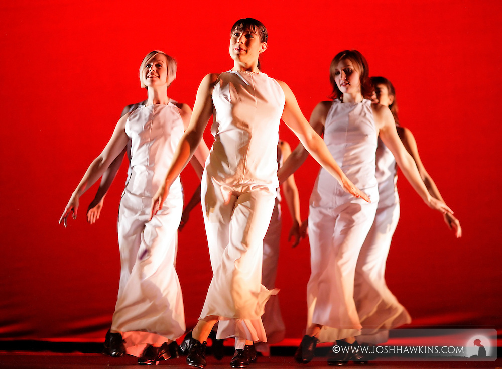 Stacy Milam, Laura Chiuve, and Kedra Jorstad dance in Tidings of Tap for Chicago Tap Theatre at UIC Theater in Chicago.