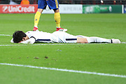 Son Heung-Min of Tottenham Hotspur (7) laying face down on the pitch during the Champions League match between Tottenham Hotspur and Juventus FC at Wembley Stadium, London, England on 7 March 2018. Picture by Matthew Redman.