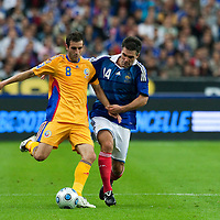 05 September 2009: Romanian player Maximilian Nicu vies with French defender Jeremy Toulalan during the World Cup 2010 qualifying football match France vs. Romania (1-1), on September 5, 2009 at the Stade de France stadium in Saint-Denis, near Paris, France.