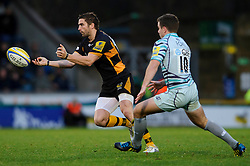 Wasps Fly-Half (#10) Nick Robinson passes as Leicester Fly-Half (#10) George Ford defends during the second half of the match - Photo mandatory by-line: Rogan Thomson/JMP - Tel: Mobile: 07966 386802 25/11/2012 - SPORT - RUGBY - Adams Park - High Wycombe. London Wasps v Leicester Tigers - Aviva Premiership.