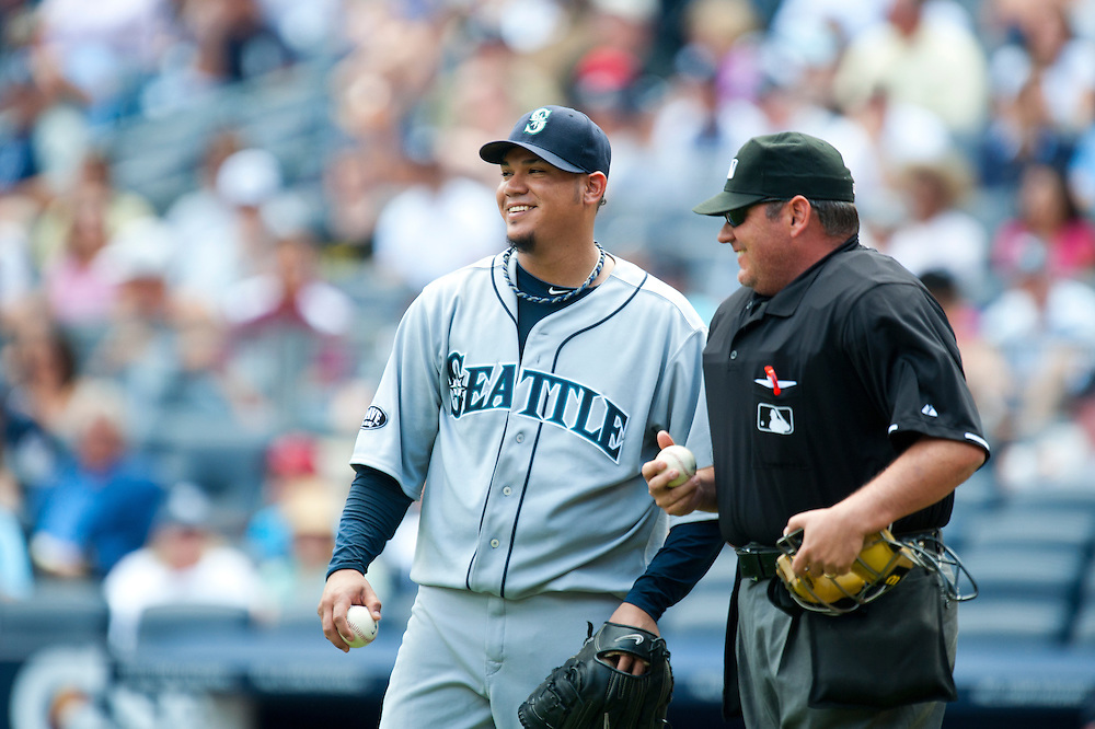 NEW YORK - JULY 27: Felix Hernandez #34 of the Seattle Mariners talks with the home plate umpire during the game against the New York Yankees at Yankee Stadium on July 27, 2011 in the Bronx borough of Manhattan. (Photo by Rob Tringali) *** Local Caption *** Felix Hernandez