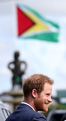 Prince Harry lays a wreath at the Guyana Independence Arch in Georgetown after arriving in the South American country on the final stop of his 15-day tour of the Caribbean.