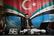 Abdula Aziz Njar, the coordinator of wounded fighters in Kilis, Turkey, in his office in the All Tawhid Medical Foundation. He has been providing medical services for Syrians in Turkey since 2012. Liwa Al Tawhid is a military brigade who organizes it's own hospitals in apartments and office buildings. The brigade arranges the transportation of wounded fighters and civilians from Aleppo to Turkey. Every patient has to bring his own nurse, a family member of a comrade. 3000 patients have received help from the  All Tawhid Medical Foundation, who receives 18 wounded per day.