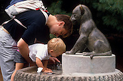 Kaare Sunnarvik and his son, Morten, at a drinking fountain.©1988 Edward McCain. All rights reserved. McCain Photography, McCain Creative, Inc.
