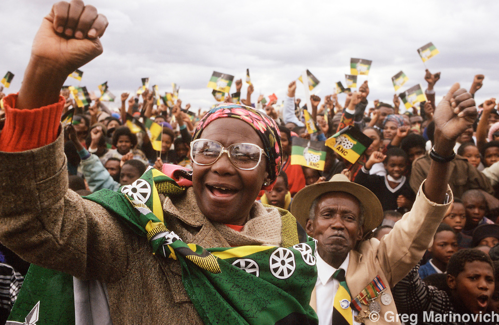 ANC supporters ahead of a storm wait for Nelson Mandela to arrive at a pre-election rally, South Africa 1994.