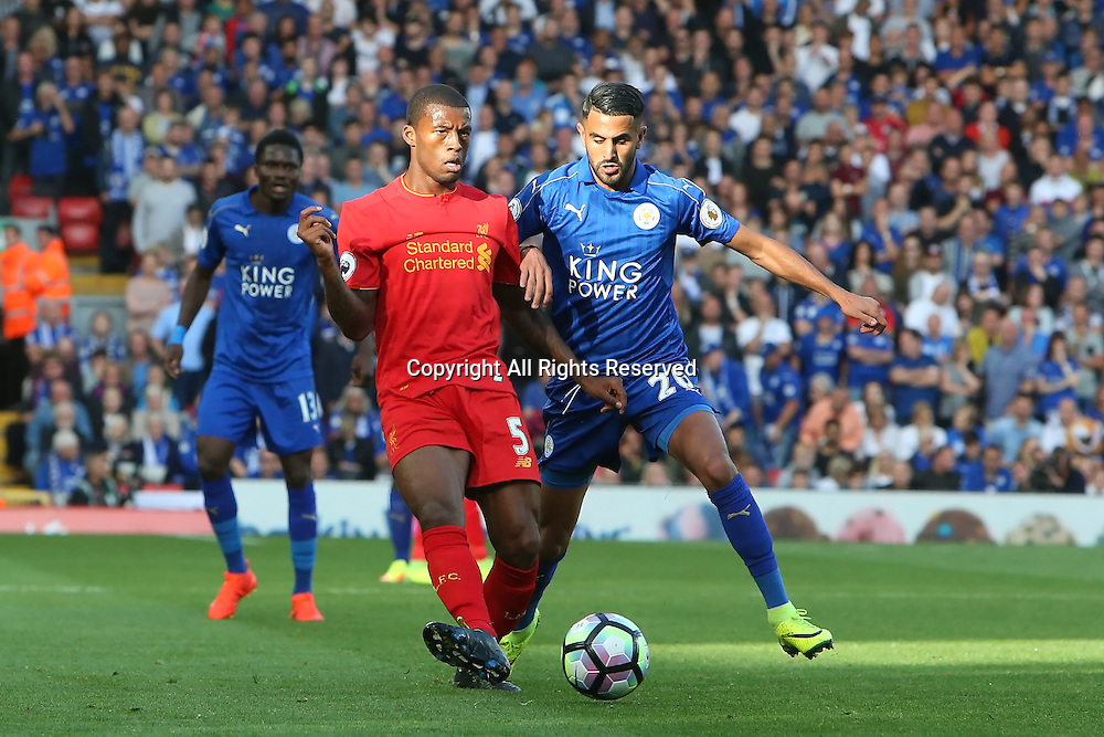 10.09.2016. Anfield, Liverpool, England. Premier League Football. Liverpool versus Leicester. Georginio Wijnaldum of Liverpool  holds off Riyad Mahrez of Leicester City