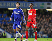 Chelsea's Cesc Fàbregas and Liverpool Raheem Sterling during the Capital One Cup match between Chelsea and Liverpool at Stamford Bridge, London, England on 27 January 2015. Photo by Phil Duncan.