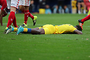 AFC Wimbledon defender Deji Oshilaja (4) with face to ground during the EFL Sky Bet League 1 match between Charlton Athletic and AFC Wimbledon at The Valley, London, England on 28 October 2017. Photo by Matthew Redman.