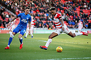 Doncaster Rovers forward Mallik Wilks (7) with a shot during the EFL Sky Bet League 1 match between Doncaster Rovers and Peterborough United at the Keepmoat Stadium, Doncaster, England on 9 February 2019.