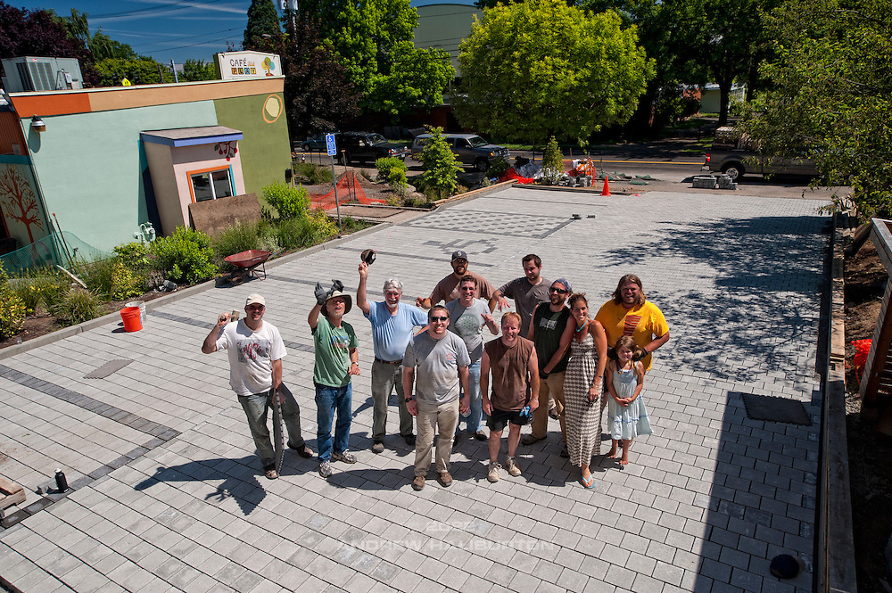 Volunteer work party completes laying pavers for the pervious pavement parking lot (L-R): Adam Zucker, Gary Riggs, Charles Heying, Dustin Elmore, Bo Lassiter, Josh Lighthipe Fred Davis, Mitchel Frister, Rick Wasserloos, Jenn Wilson, Maggie Wilson, Pete Wilson. Café au Play at Tabor Commons, a project of the Southeast Uplift Neighborhood Coalition (SEUL) and volunteers from Portland's Mt Tabor neighborhood.