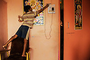 Vinyak, 10, checks the recharging of the family mobile phone. India is the country in the world with most mobile phones per capita.