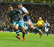 Sheffield Wednesday Defender, Liam Palmer gets the ball put of play and away fromBlackburn Rovers Midfielder, Craig Conway during the Sky Bet Championship match between Blackburn Rovers and Sheffield Wednesday at Ewood Park, Blackburn, England on 28 November 2015. Photo by Mark Pollitt.