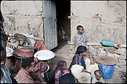 "Zennahu (in the room), 3 years old, is being married, with a young guy, 13 years older. Child marriages are typically made for economic or political reasons. In Ethiopia survives the practice of forced child marriage, even though is forbidden by the law, quite often ignored. North West of Ethiopia, on monday, Febrary 16 2009.....In a tangled mingling of tradition and culture, in the normal place of living, in a laid-back attitude. The background of Ethiopia's ""child brides"", a country which has the distinction of having highest percentage in the practice of early marriages despite having a law that establishes 18 years as minimum age to get married. Celebrations that last days, their minds clouded by girls cups of tella and the unknown for the future. White bridal veil frame their faces expressive of small defenseless creatures, who at the age ranging from three to twelve years shall be given to young brides men adults already...To protect the identities of the recorded subjects names and specific places are fictional."