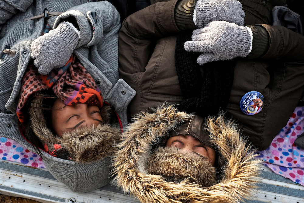 Supporters nap on the National Mall before the Second Inauguration of President Barack Obama on Jan. 21, 2013.