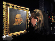 35559258© Licensed to London News Pictures. 27/10/2011. London, UK. A member of Bonhams staff hold the painting. A previously unknown portrait by the Spanish artist Diego Rodriguez de Silva y Velazquez (1599-1660) is unveiled at Bonhams Auction House in London today, 27th October. The work is a portrait of a gentleman in a black tunic and white collar and is expected to fetch 2-3million GBP.  Photo: Stephen Simpson/LNP