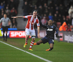 Stoke City's Glenn Whelan barges Manchester United's Ashley Young onto the floor. - Photo mandatory by-line: Alex James/JMP - Tel: Mobile: 07966 386802 01/02/2014 - SPORT - FOOTBALL - Britannia Stadium - Stoke-On-Trent - Stoke v Manchester United - Barclays Premier League