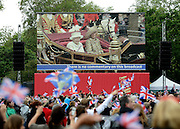 © Licensed to London News Pictures. 05/06/2012. London, UK. People watch the Jubilee Procession on Giant Screens from St James Park on the Mall today 5th June 2012.  The Royal Jubilee celebrations. Great Britain is celebrating the 60th  anniversary of the countries Monarch HRH Queen Elizabeth II accession to the throne this weekend Photo credit : Stephen Simpson/LNP