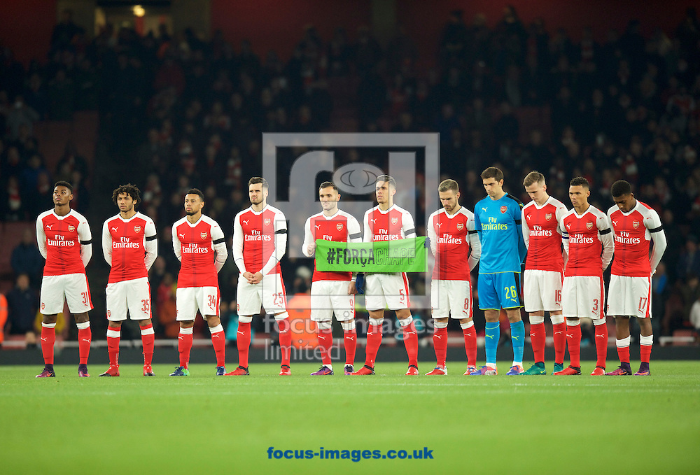 Arsenal players stand for a minutes silence in respect of those that lost their lives in the Columbian air crash before the EFL Cup match at the Emirates Stadium, London<br /> Picture by Alan Stanford/Focus Images Ltd +44 7915 056117<br /> 30/11/2016