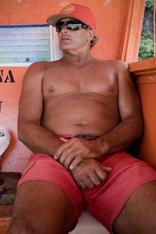 Bruce, lifegard at Haena Beach, in Kauai, Hawai, watches the ocean during his duty.