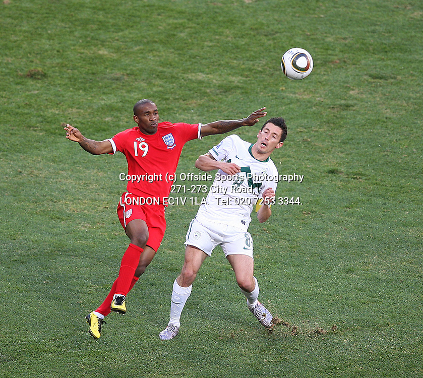 23/06/2010 World Cup. Slovenia v England.<br /> Jermain Defoe and Robert Koren.<br /> Photo: Mark Leech.