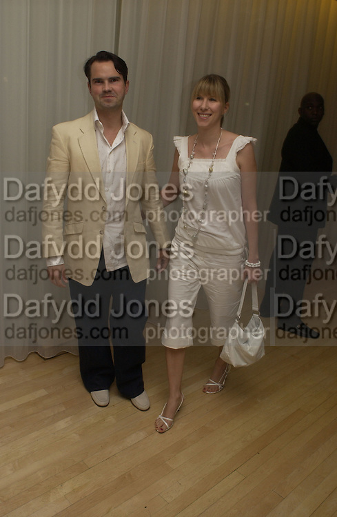Jimmy Carr and  Caroline Copping.Post premiere party for the Island at the Sanderson Hotel. . 7 August 2005. , ONE TIME USE ONLY - DO NOT ARCHIVE  © Copyright Photograph by Dafydd Jones 66 Stockwell Park Rd. London SW9 0DA Tel 020 7733 0108 www.dafjones.com