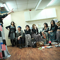 Miri Beillin, an ultra orthodox Jewish woman, works as a stylist during a fashion show for ultra orthodox women and guides the models behind the scenes, before they go on stage.