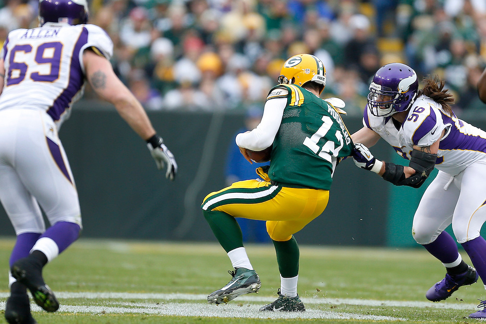 GREEN BAY, WI - DECEMBER 2:  Brian Robison #96 of the Minnesota Vikings grabs Aaron Rodgers #12 of the Green Bay Packers at Lambeau Field on December 2, 2012 in Green Bay, Wisconsin.  The Packers defeated the Vikings 23-14.  (Photo by Wesley Hitt/Getty Images) *** Local Caption *** Brian Robison; Aaron Rodgers
