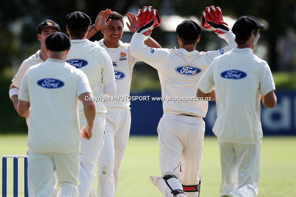 Wellington celebrate a wicket, Plunket Shield, 4 day domestic cricket. Auckland Aces v Wellington Firebirds, Colin Maiden Park, Auckland. 23 March 2011. Photo: William Booth/photosport.co.nz
