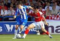 Photo: Ashley Pickering.<br /> Colchester United v Charlton Athletic. Coca Cola Championship. 15/09/2007.<br /> Johnnie Jackson of Colchester (L) holds off Charlton goal scorer Zheng Zhi