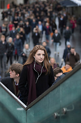 © Licensed to London News Pictures. 09/01/2017. London, UK. Commuters climb the steps to The Golden Jubilee footbridge as they cross the Thames on foot as a 24 hour London Underground tube strike takes hold.  All Zone one tube stations are closed until 6PM tonight after members of the RMT and the Transport Salaried Staffs' Association unions walked out after talks with TFL collapsed.  Photo credit: Peter Macdiarmid/LNP