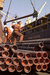 Tianjin, China,exporting, dock workers, Chinese, shipping, port, trucks, export, industrial, shipping steel pipe