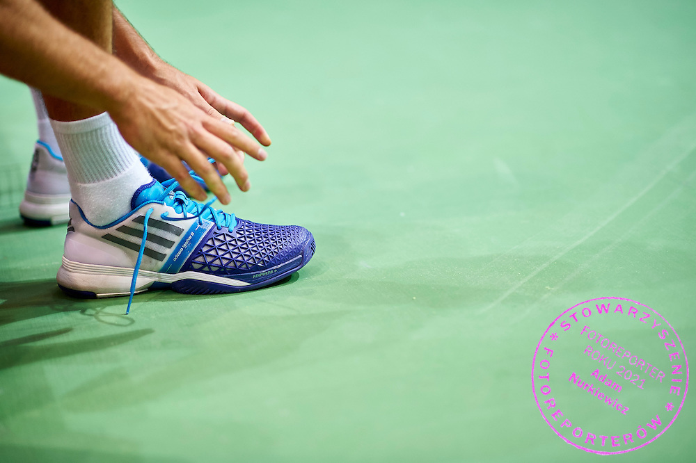 Jerzy Janowicz of Poland and his Adidas shoes during training session two days before Davis Cup Tie World Group Play-off Poland v Slovakia at Gdynia Arena in Gdynia, Poland.<br /> <br /> Poland, Gdynia, September 16, 2015<br /> <br /> Picture also available in RAW (NEF) or TIFF format on special request.<br /> <br /> For editorial use only. Any commercial or promotional use requires permission.<br /> <br /> Adam Nurkiewicz declares that he has no rights to the image of people at the photographs of his authorship.<br /> <br /> Mandatory credit:<br /> Photo by &copy; Adam Nurkiewicz / Mediasport