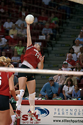 25 September 2004    Redbirds Laura Doornbos with a hammer slam.     Illinois State University Redbirds V University of Northern Iowa Panthers Volleyball.  Redbird Arena, Illinois State University, Normal IL