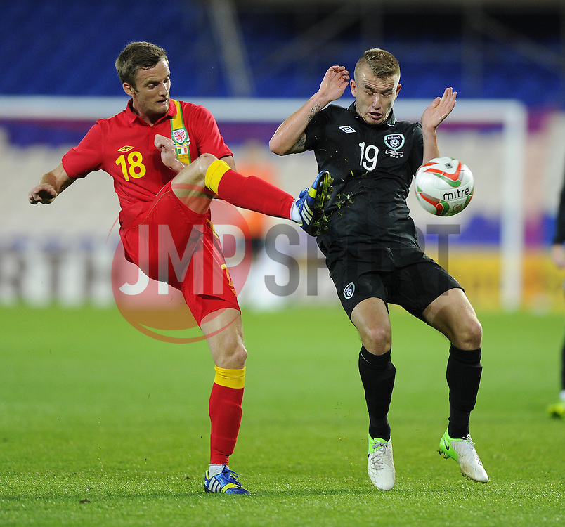 Andy King of Wales (Leicester City) battles for the ball with Paddy Madden of Republic of Ireland (Yeovil Town)  - Photo mandatory by-line: Joe Meredith/JMP - Tel: Mobile: 07966 386802 14/08/2013 - SPORT - FOOTBALL - Cardiff City Stadium - Cardiff -  Wales V Republic of Ireland - International Friendly