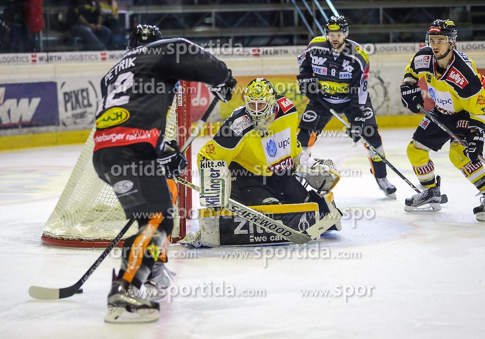 18.10.2015, Messestadion, Dornbirn, AUT, EBEL, Dornbirner Eishockey Club vs UPC Vienna Capitals, 12. Runde, im Bild Nicolas Petrik, (Dornbirner Eishockey Club, #12), David Kickert, (UPC Vienna Capitals #30), Marek Zaprapan, (Dornbirner Eishockey Club, #08) und Tyler Puma, (UPC Vienna Capitals #19)// during the Erste Bank Icehockey League 12th round match between Dornbirner Eishockey Club and UPC Vienna Capitals at the Messestadion in Dornbirn, Austria on 2015/10/18, EXPA Pictures © 2015, PhotoCredit: EXPA/ Peter Rinderer