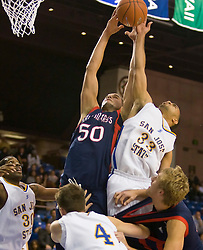 November 30, 2009; San Jose, CA, USA;  Saint Mary's Gaels center Omar Samhan (50) grabs a rebound from San Jose State Spartans guard Mac Peterson (33) during the second half at the Event Center Arena.  Saint Mary's defeated San Jose State 78-71.