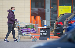 ©Licensed to London News Pictures 30/04/2020  <br /> Dartford, UK. A shopper pushing a trolley of flowers back to the car outside B&Q warehouse store in Dartford, Kent. B&Q have today opened all of its 288 stores in the UK. The DIY retailer has strict social distancing measures in place. Photo credit:Grant Falvey/LNP