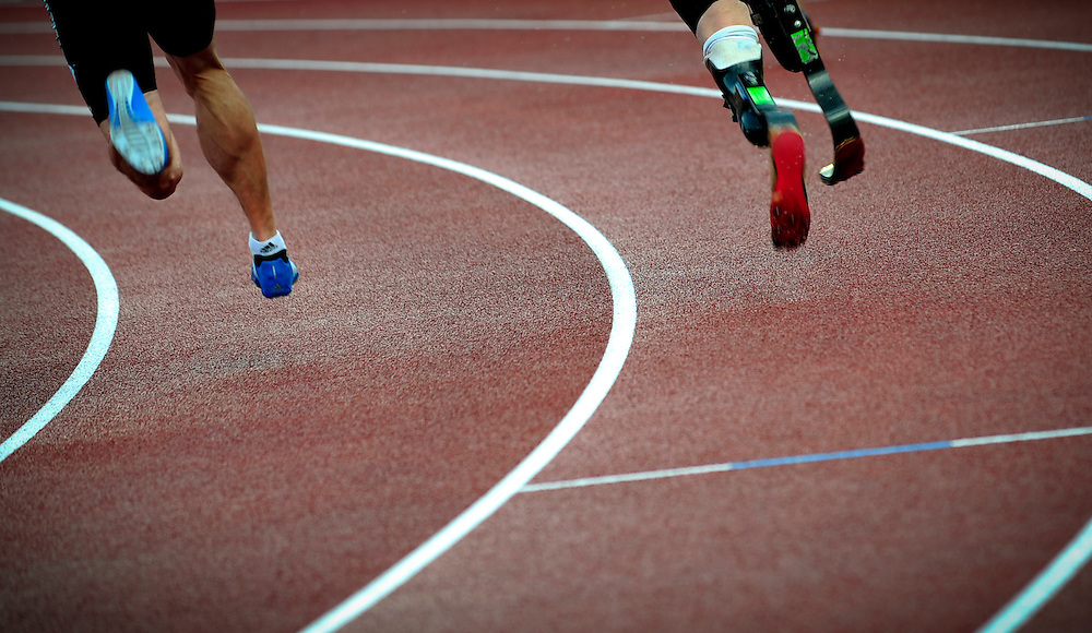 Oscar Pistorius of South Africa (R) competes in the 400m final B