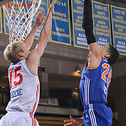 Westchester Knicks Guard TRAVIS TRICE II (20) drives towards the basket as Delaware 87ers Guard TY GREENE (15) defends in the first half of a NBA D-league regular season basketball game between the Delaware 87ers and the Westchester Knicks Tuesday, JAN, 19, 2016 at The Bob Carpenter Sports Convocation Center in Newark, DEL