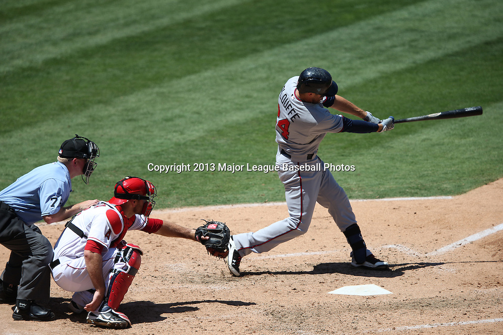 ANAHEIM, CA - JULY 24:  Trevor Plouffe #24 of the Minnesota Twins flies out for the second out in the top of the 5th inning while Chris Iannetta #17 of the Los Angeles Angels of Anaheim catches and home plate umpire Mike Muchlinski #76 calls balls and strikes during the game against the Los Angeles Angels of Anaheim on Wednesday, July 24, 2013 at Angel Stadium in Anaheim, California. The Angels won the game in a 1-0 shutout. (Photo by Paul Spinelli/MLB Photos via Getty Images) *** Local Caption *** Trevor Plouffe;Chris Iannetta;Mike Muchlinski