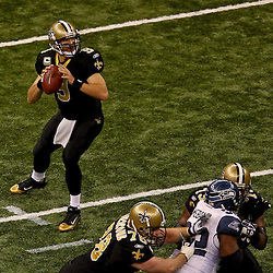 November 21, 2010; New Orleans, LA, USA;  New Orleans Saints quarterback Drew Brees (9) looks to pass during the first quarter against the Seattle Seahawks at the Louisiana Superdome. The Saints defeated the Seahawks 34-19. Mandatory Credit: Derick E. Hingle