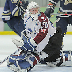 "FORT FRANCES, ON - Apr 29, 2015 : Central Canadian Junior ""A"" Championship, game action between the Toronto Patriots and the Dryden GM Ice Dogs, game three of the Dudley Hewitt Cup, Tate Sproxton #30 of the Dryden GM Ice Dogs makes the save during the second period<br /> (Photo by Amy Deroche/ OJHL Images)"