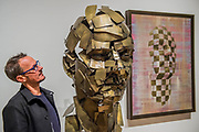 Jonathan Yeo with his sculpture Homage to Paolozzi (and other works) - a collaboration with Google Arts & Culture to create the first physical free-standing sculpture in metal made using the Virtual Reality program Tilt Brush - From Life a new exhibition at the Royal Academy of Arts. It runs from 11 December 2017 – 11 March 2018.